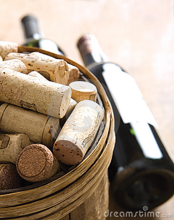 Corks in basket with bottles