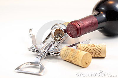 Corks, red wine and corkscrew