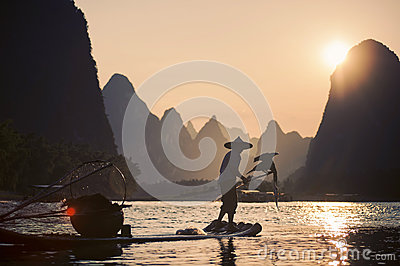 Cormorant fisherman from village of Xing Ping, China Editorial Photo