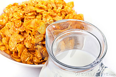 Corn flakes and jug of milk