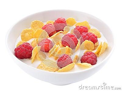 Corn flakes and raspberries with yogurt