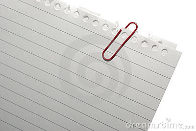 Corner of blank note paper with red paper-clip.