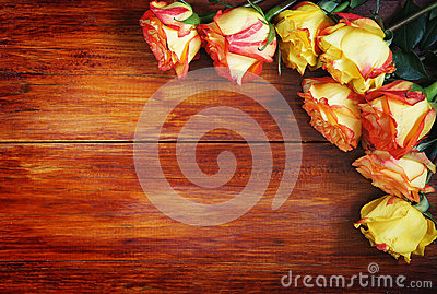 Corner Made of Roses Over a Wooden Background