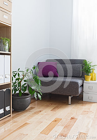 Free Corner Of A Living Room With Gray Armchair And Plants Stock Image - 35797691