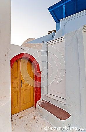 Corner of the street with yellow door