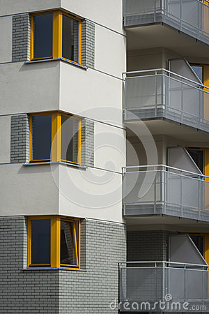Corner yellow wooden windows in multi family house