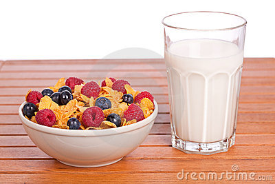 Cornflakes with fruits and milk tumbler