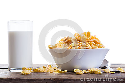 Cornflakes with milk on wooden table Stock Photo
