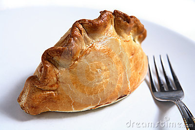 Cornish pasty meat pie and fork