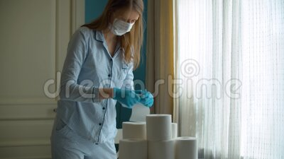 Panic buying. Young woman examining toilet paper stocks that she bought in connection with the epidemic. Covid-19 pandemic stock video footage