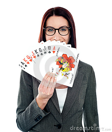 Corporate lady hiding her smile with playing cards