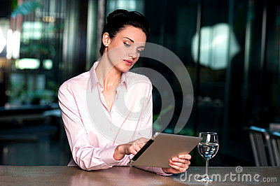 Corporate lady operating her tablet device