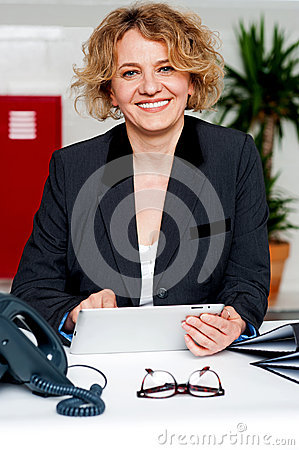 Corporate lady operating wireless tablet device