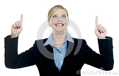 Corporate lady pointing upwards with both hands