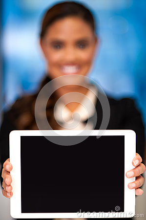 Corporate lady showing tablet device