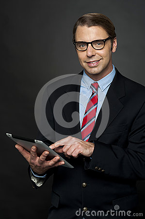 Corporate male operating tablet pc
