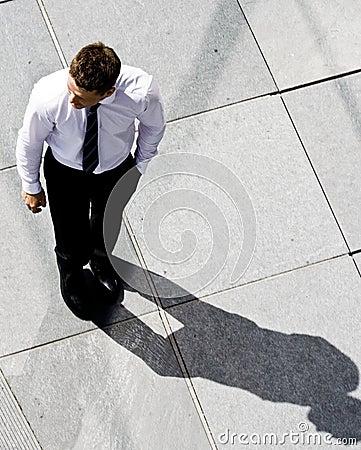 Corporate Man On The Sidewalk