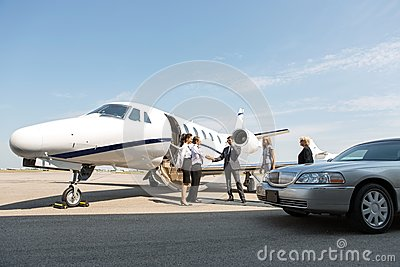 Corporate People Greeting Airhostess And Pilot At Stock Photo  Image 37130920