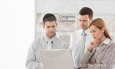 Corporate people looking at laptop screen