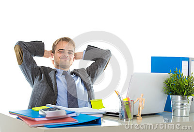 Corporate portrait of young attractive businessman leaning back on his chair relaxed and smiling happy Stock Photo