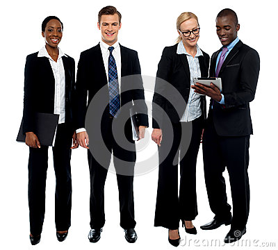 Corporate team of four posing with tablet pc