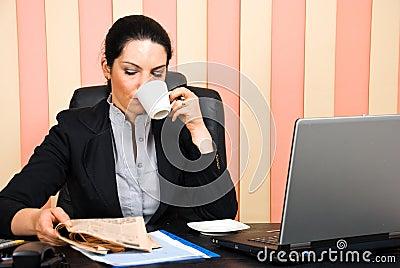 Corporate woman reading news