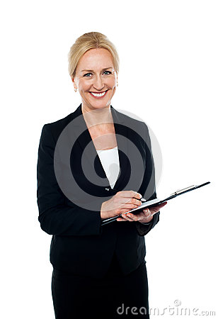 Corporate woman writing on clipboard