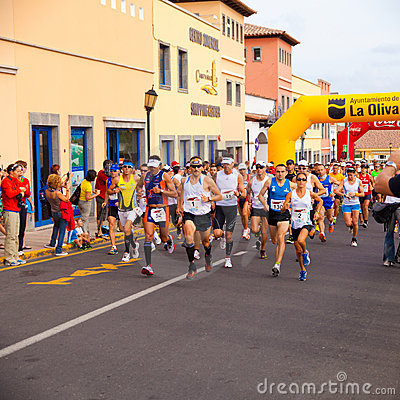 CORRALEJO - OCTOBER 30:  Runners start the race Editorial Stock Image