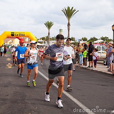 CORRALEJO - OCTOBER 30:  Runners start the race Editorial Stock Photo