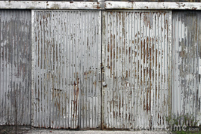 Corrugated door at abandoned factory building