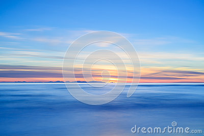 Corsica or Corse island sunset view from Italian beach coast.