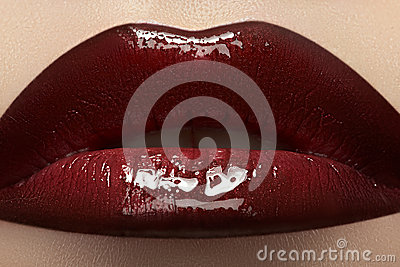 Cosmetic. Close fashion cherry lips glossy make-up