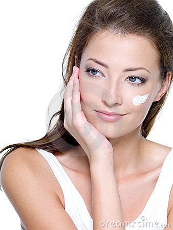cosmetic cream on women face