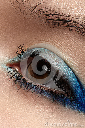 Cosmetic. Macro of sky-blue eye make-up, eyelashes