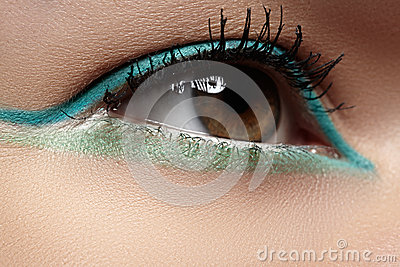 Cosmetics, close-up eye make-up. Fashion eyeshadow