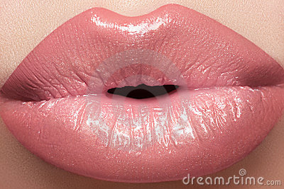 Cosmetics, gloss make-up. Macro fashion lips kiss