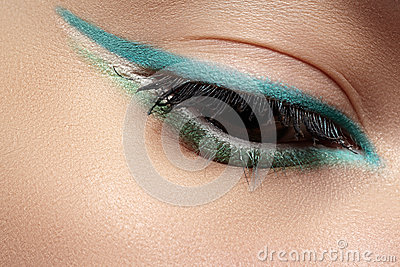 Cosmetics, macro eye make-up. Fashion mint liner eyeshadows