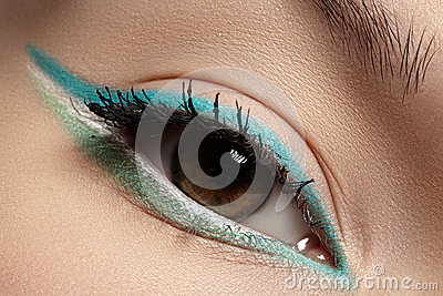 Cosmetics, macro eye make-up. Fashion mint shadows