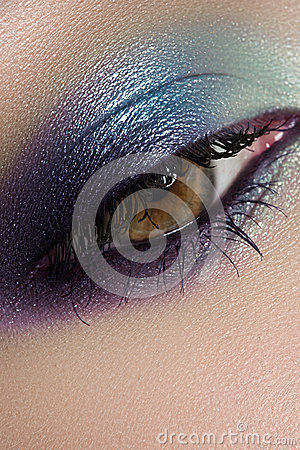 Cosmetics, macro eye make-up. Fashion sea shadows