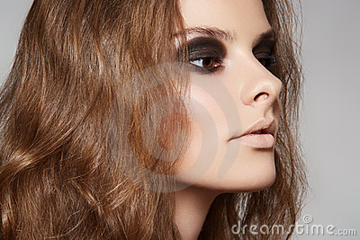 Cosmetics and make-up. Model with volume long hair