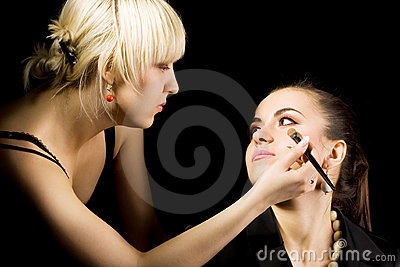 Cosmetologist doing make-up