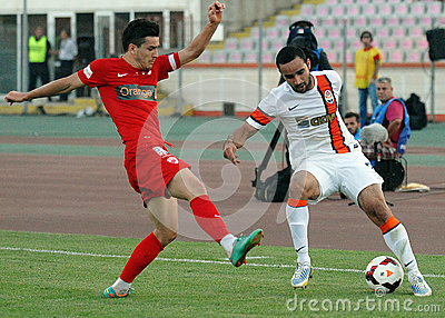 Cosmin Matei and Ismaily in Dinamo Bucharest-Shaktar Donetk Editorial Stock Image