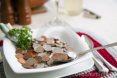Cost of living with spoonful Editorial Image