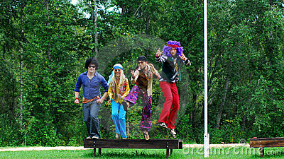 Costumed adults jumping in air