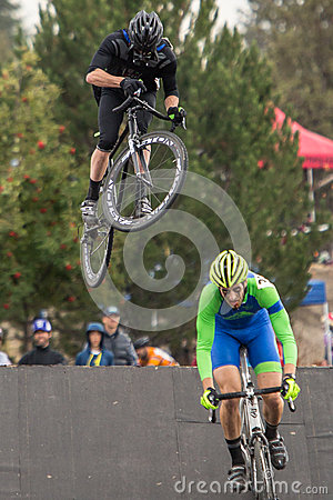 Costumed Bicycle Racer - big air on road bike Editorial Photography