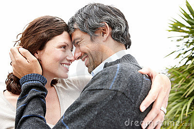 Cosy mature couple looking at each other - Outdoor