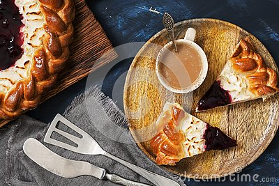 Cottage cheese cake with berry jam and coffee on a dark blue background. Top view, flat lying Stock Photo