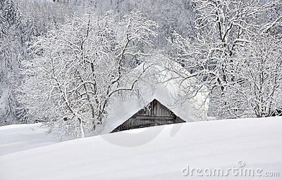 Cottage nestled in the snowy mountain