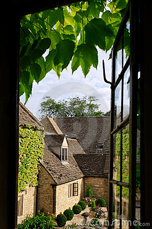 Cottage view through ivy
