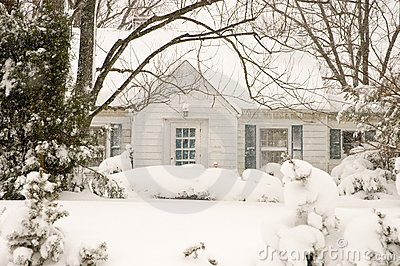 Cottage in winter snowstorm